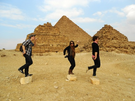 Three kids walking like Egyptians