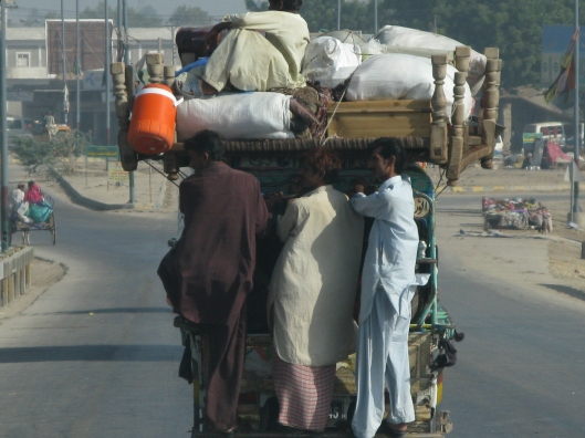 Pakistan - Displaced people returning to villages after losing much when their homes flooded.