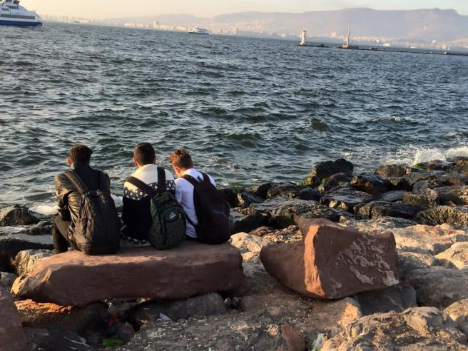 refugees waiting by the sea